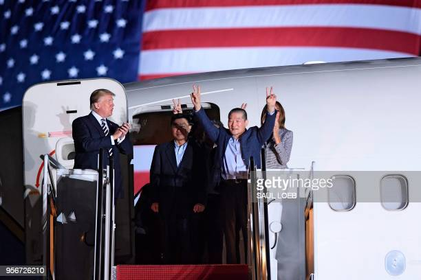 President Donald Trump applauds as US detainee Kim Dongchul gestures upon his return with Kim Haksong and Tony Kim after they were freed by North...