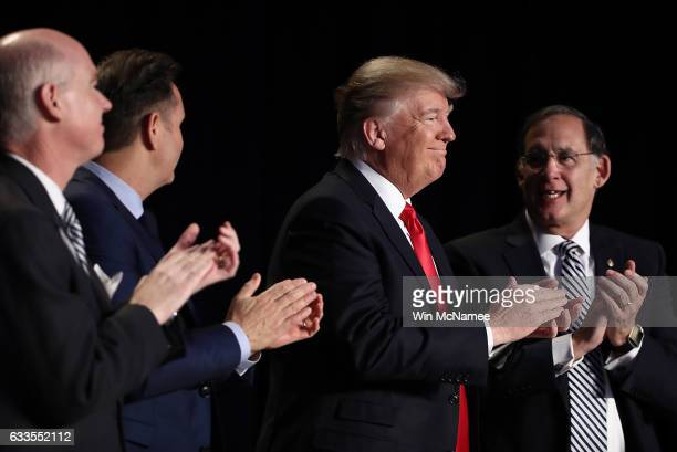 US President Donald Trump applauds at the National Prayer Breakfast February 2 2017 in Washington DC Every US president since Dwight Eisenhower has...
