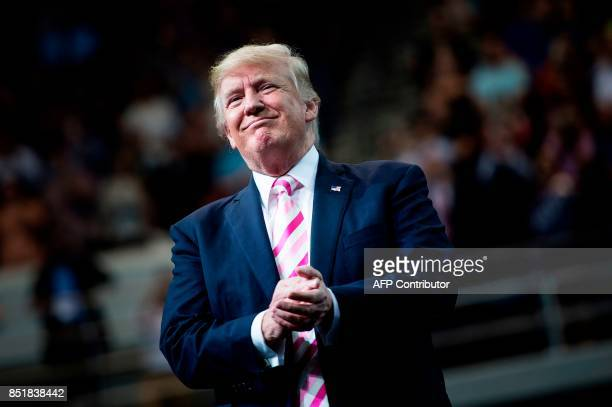 US President Donald Trump applauds during a rally for Sen Luther Strange at the Von Braun Civic Center September 22 2017 in Huntsville Alabama Trump...