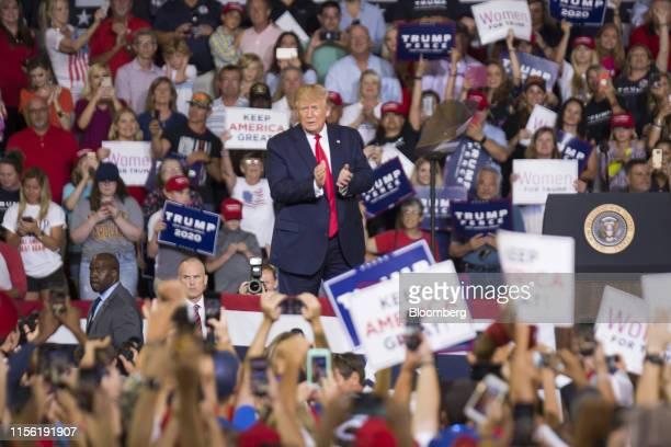US President Donald Trump applauds during a rally in Greenville North Carolina US on Wednesday July 17 2019 Trumpissued his most extensive criticism...