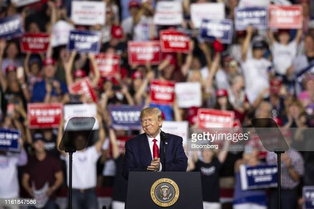 US President Donald Trump applauds during his speech a rally in Manchester New Hampshire US on Thursday Aug 15 2019 Trump arrived for a rally in...