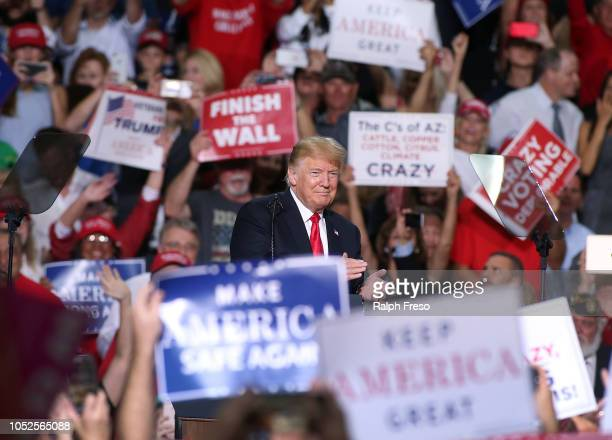 President Donald Trump applauds the crowd of supporters during a rally at the International Air Response facility on October 19 2018 in Mesa Arizona...