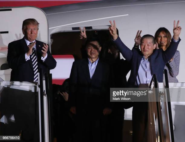 S President Donald Trump applauds the three Americans just released from North Korea Kim Dong Chul Kim Haksong and Tony Kim at Joint Base Andrews on...