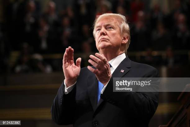 US President Donald Trump applauds while delivering a State of the Union address to a joint session of Congress at the US Capitol in Washington DC US...