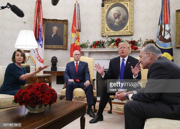 S President Donald Trump argues about border security with Senate Minority Leader Chuck Schumer and House Minority Leader Nancy Pelosi as Vice...