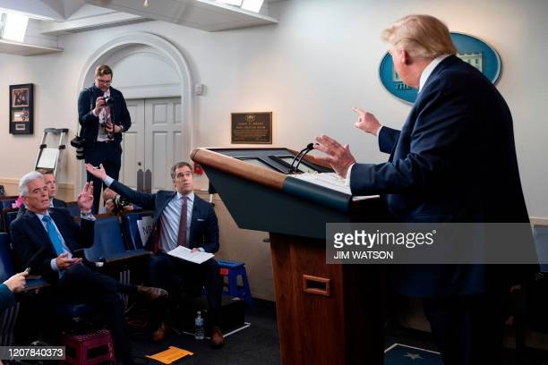 US President Donald Trump argues with NBC's Peter Alexander during the daily briefing on the novel coronavirus COVID19 at the White House on March 20...