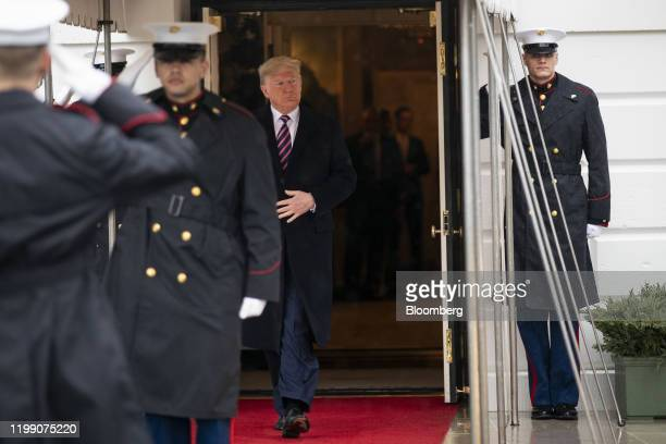 US President Donald Trump arrive to greet Uhuru Kenyatta Kenya's president not pictured outside of the White House in Washington DC US on Thursday...