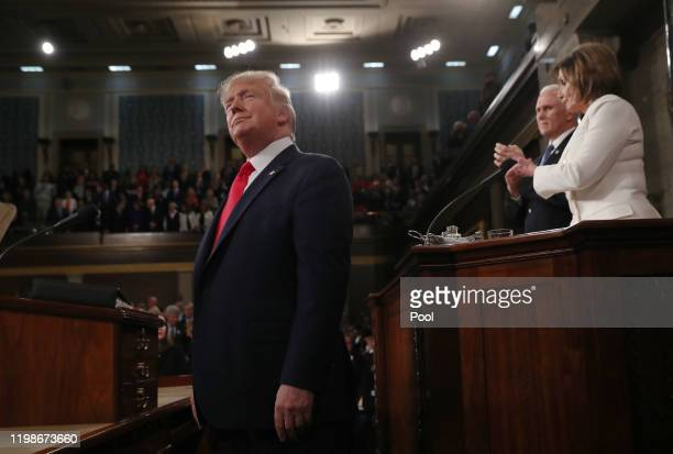 President Donald Trump arrives as House Speaker Nancy Pelosi and Vice President Mike Pence look on before the State of the Union address in the House...