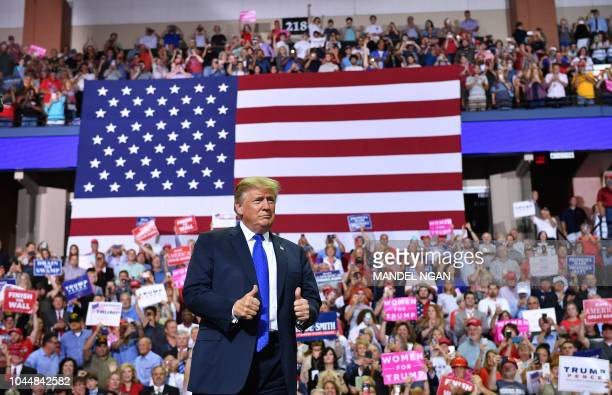 US President Donald Trump arrives at a Make America Great Again rally at Landers Center in Southaven Mississippi on October 2 2018