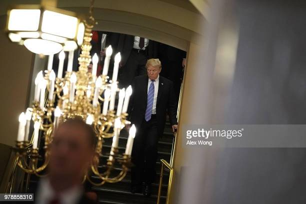 S President Donald Trump arrives at a meeting with House Republicans at the US Capitol June 19 2018 in Washington DC Trump was on the Hill to discuss...