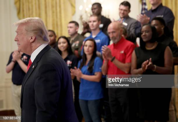 S President Donald Trump arrives at an event where he signed an executive order establishing a National Council for the American Worker and requested...