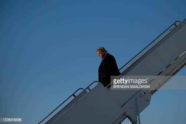 President Donald Trump arrives at La Crosse Regional Airport October 27 in La Crosse, Wisconsin. - Democrat Joe Biden was campaigning in the once...