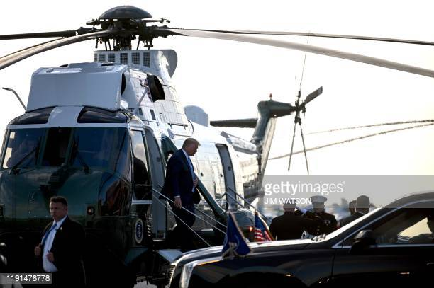 US President Donald Trump arrives at Miami Executive Airport in Miami Florida on January 3 2020