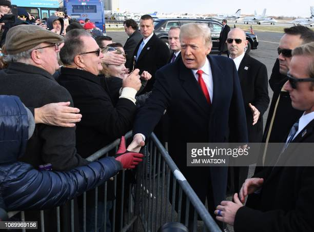 US President Donald Trump arrives at Philadelphia International Airport to attend the annual ArmyNavy football game December 8 2018 Trump will...