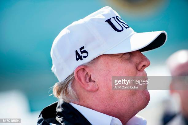 US President Donald Trump arrives at Southwest Florida International Airport September 14 2017 in Fort Myers Florida Trump toured damage caused by...
