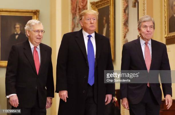 US President Donald Trump arrives at the US Capitol alongside US Senate Majority Leader Sen Mitch McConnell and Sen Roy Blunt before joining Senate...