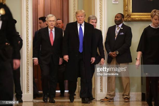 President Donald Trump arrives at the U.S. Capitol alongside U.S. Senate Majority Leader Sen. Mitch McConnell and Sen. Roy Blunt before joining...
