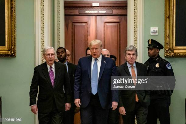 President Donald Trump arrives at the US Capitol to attend the Republicans weekly policy luncheon on March 10, 2020 in Washington, DC. He is flanked...