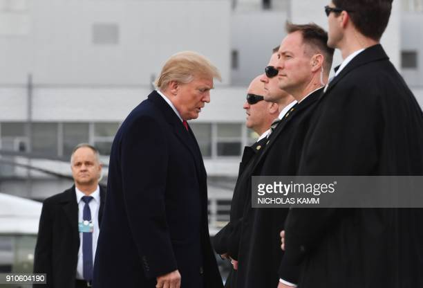 US President Donald Trump arrives before boarding the Air Force One ahead of his departure from Zurich Airport in Zurich on January 26 after...
