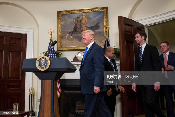 US President Donald Trump arrives before making an announcement on the introduction of the Reforming American Immigration for a Strong Economy Act...