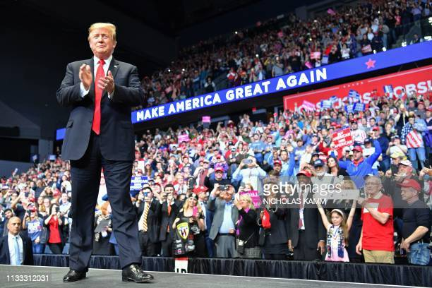 US President Donald Trump arrives for a campaign rally in Grand Rapids Michigan on March 28 2019
