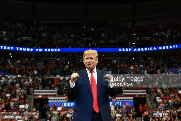 """President Donald Trump arrives for a """"Keep America Great"""" campaign rally at the BB&T Center in Sunrise, Florida on November 26, 2019."""