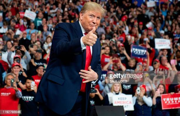 "President Donald Trump arrives for a ""Keep America Great"" campaign rally at Huntington Center in Toledo, Ohio, on January 9, 2020."