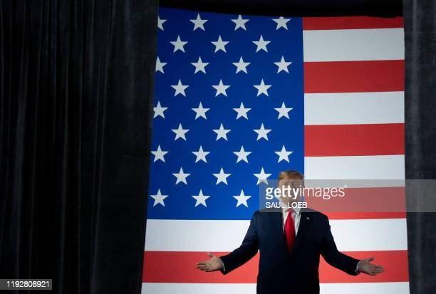"""President Donald Trump arrives for a """"Keep America Great"""" campaign rally at Huntington Center in Toledo, Ohio, on January 9, 2020."""