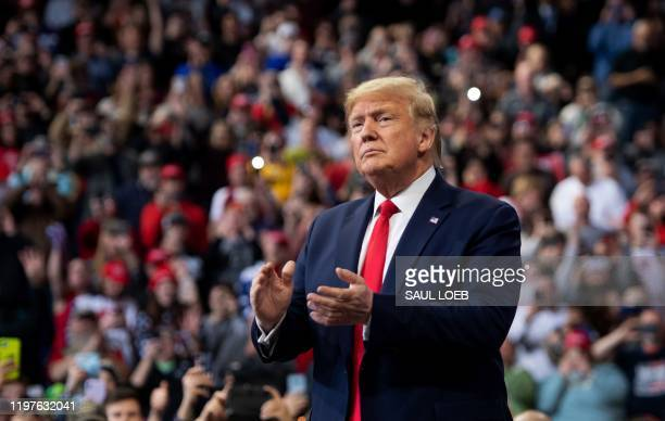 """President Donald Trump arrives for a """"Keep America Great"""" campaign rally at Drake University in Des Moines, Iowa, January 30, 2020."""