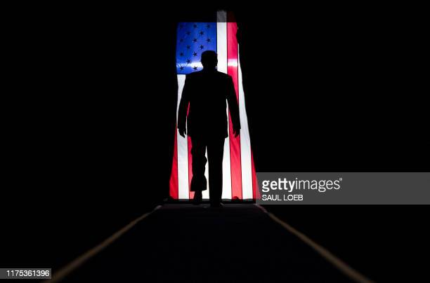 """President Donald Trump arrives for a """"Keep America Great"""" rally at Sudduth Coliseum at the Lake Charles Civic Center in Lake Charles, Louisiana, on..."""