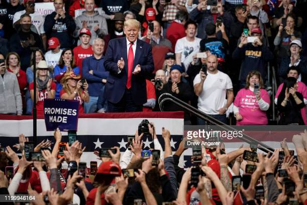 S President Donald Trump arrives for a Keep America Great rally at Southern New Hampshire University Arena on February 10 2020 in Manchester New...