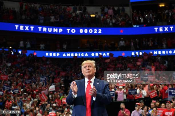 """President Donald Trump arrives for a """"Keep America Great"""" rally at the American Airlines Center in Dallas, Texas on October 17, 2019."""