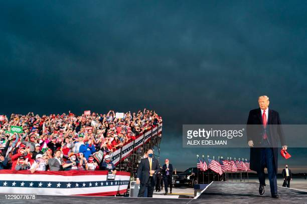 President Donald Trump arrives for a Make America Great Again campaign event at Des Moines International Airport in Des Moines, Iowa on October 14,...