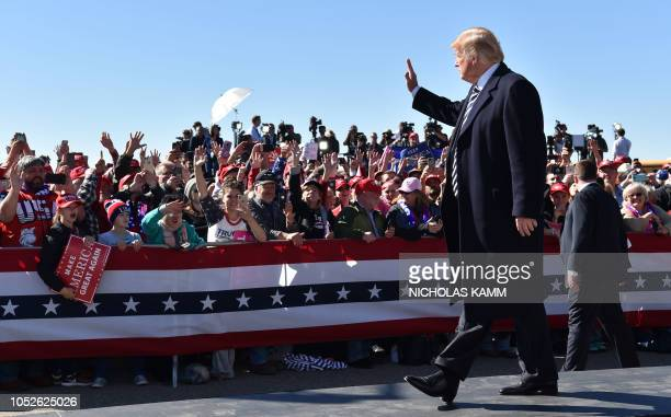 US President Donald Trump arrives for a Make America Great Again rally at Elko Regional Airport in Elko Nevada October 20 2018