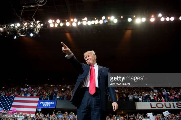 US President Donald Trump arrives for a 'Make America Great Again' rally at the Kentucky Exposition Center in Louisville Kentucky March 20 2017 While...