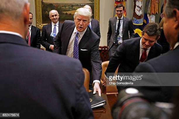 S President Donald Trump arrives for a meeting with invited business leaders including Alex Gorsky of Johnson Johsnson and members of his staff...