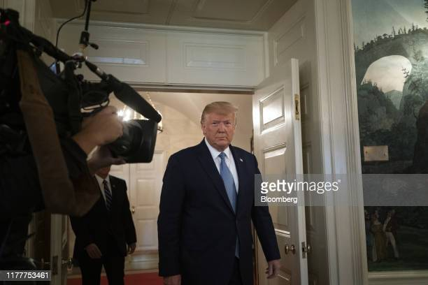 US President Donald Trump arrives for a news conference at the White House in Washington DC US on Wednesday Oct 23 2019 Trumpsaid he is lifting...