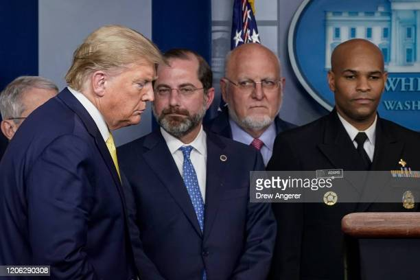 President Donald Trump arrives for a press conference as Alex Azar, Secretary of Health and Human Services, Robert Redfield, Director of the Centers...