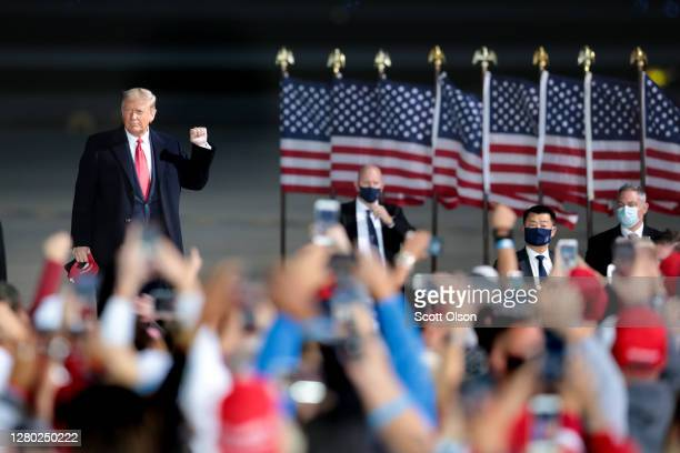 President Donald Trump arrives for a rally at the Des Moines International Airport on October 14, 2020 in Des Moines, Iowa. According to a recent...