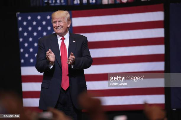 President Donald Trump arrives for a rally on June 21, 2017 in Cedar Rapids, Iowa. Trump spoke about renegotiating NAFTA and building a border wall...