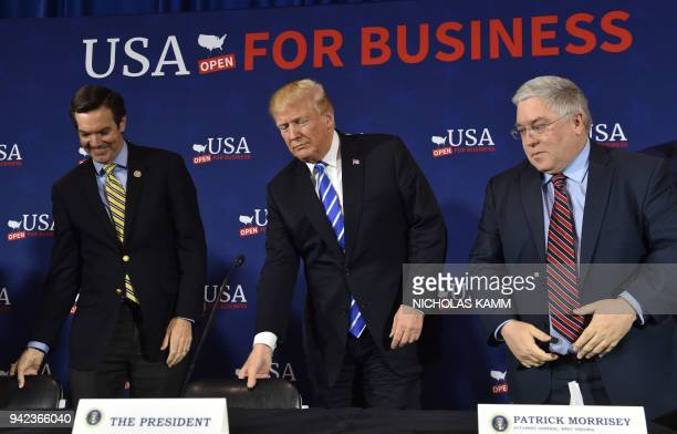 US President Donald Trump arrives for a round table discussion on tax reform at White Sulpher Springs Civic Center in White Sulpher SpringsWest...