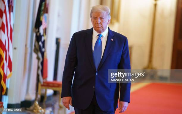 US President Donald Trump arrives for an event honoring Bay of Pigs veterans in the East Room of the White House in Washington DC on September 23 2020