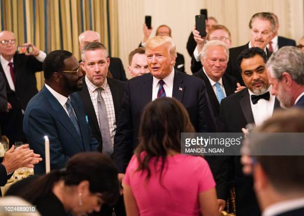 President Donald Trump arrives for an event honoring Evangelical leadership in the State Dining Room of the White House on August 27, 2018 in...