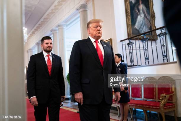 S President Donald Trump arrives for an event recognizing the Wounded Warrior Project Soldier Ride in the East Room of the White House April 18 2019...