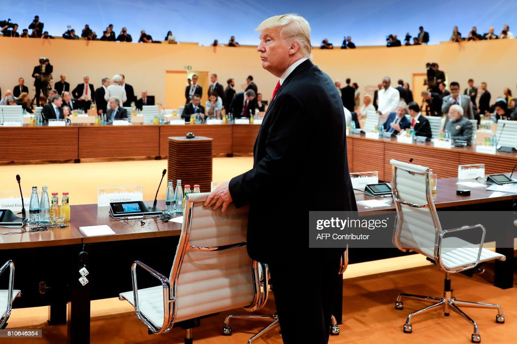 President Donald Trump arrives for another working session during the G20 summit in Hamburg, northern Germany, on July 8, 2017. Leaders of the world's top economies gather from July 7 to 8, 2017 in Germany for likely the stormiest G20 summit in years, with disagreements ranging from wars to climate change and global trade. / AFP PHOTO / POOL / Markus Schreiber
