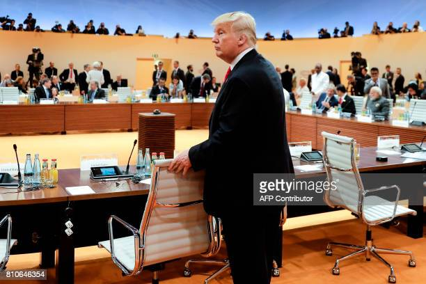 President Donald Trump arrives for another working session during the G20 summit in Hamburg northern Germany on July 8 2017 Leaders of the world's...