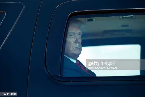 President Donald Trump arrives in a motorcade before boarding Air Force One at Joint Base Andrews in Maryland on September 12, 2020. - Trump travels...