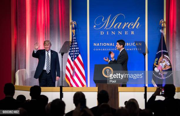 President Donald Trump arrives on stage as Speaker of the House Paul Ryan RWI applauds before Trump delivered remarks at the National Republican...