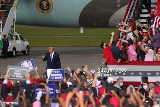 President Donald Trump arrives on stage during his 'The Great American Comeback Rally' at Cecil Airport on September 24 2020 in Jacksonville Florida...