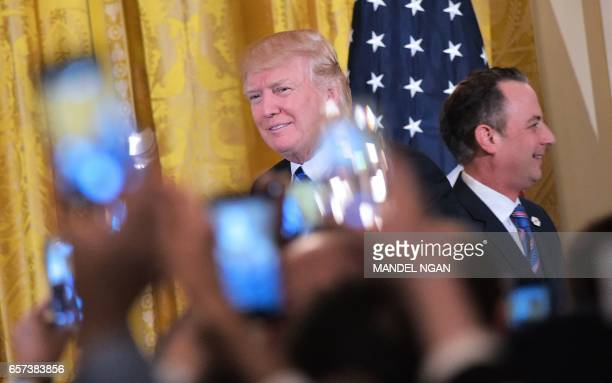 US President Donald Trump arrives on stage for a Greek Independence Day celebration after he was introduced by Chief of Staff Reince Priebus in the...